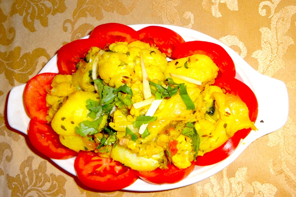 Aloo Gobhi ~ cauliflower and potatoes cooked in fresh onion, tomatoes, and spices