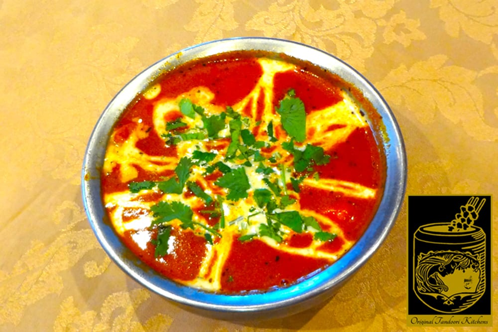 Butter Chicken ~ pieces of marinated in a special sauce, cooked in garlic, ginger, cream, and fresh tomatoes