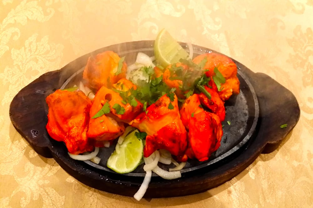 Chicken Tikka ~ Boneless chicken marinated in yogurt and ginger, served with chutney at Original Tandoori Kitchens