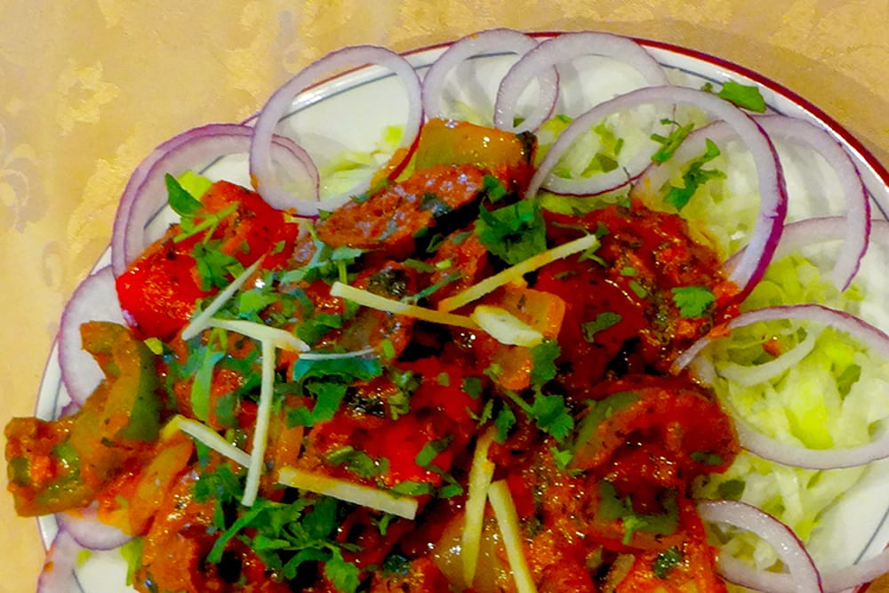 Chili Kebab ~ Lamb Seekh Kebab pieces cooked in a sauce with fresh green peppers, onions, tomatoes and spices at Original Tandoori Kitchen on Best in BC