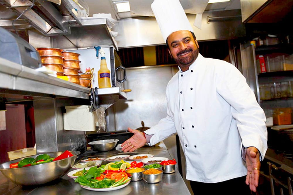 Executive Chef Sharanjit Kahlon preparing a meals at the Original Tandoori Kitchen