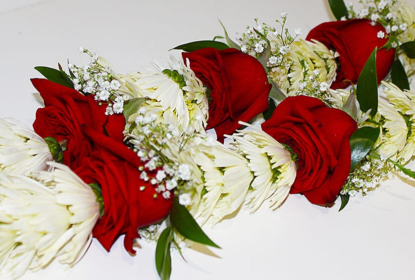 Indian Flower Garland ~ white chrysanthemums, red roses, baby's breath, green ruscus