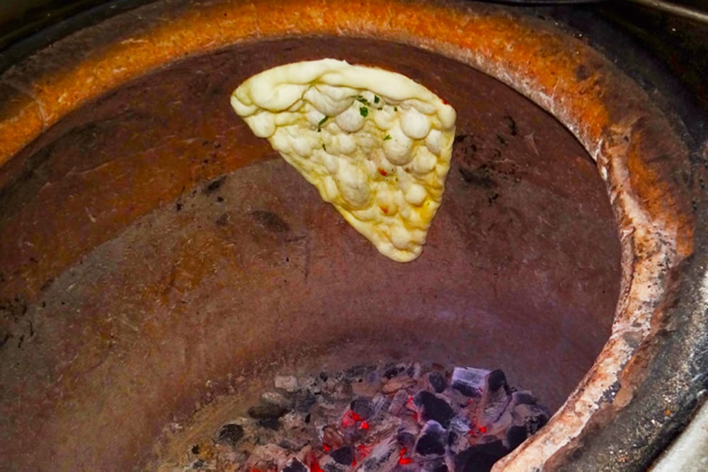 Nann is a leavened flatbread that is baked in our traditional Tandoori Oven at Original Tandoori Kitchens