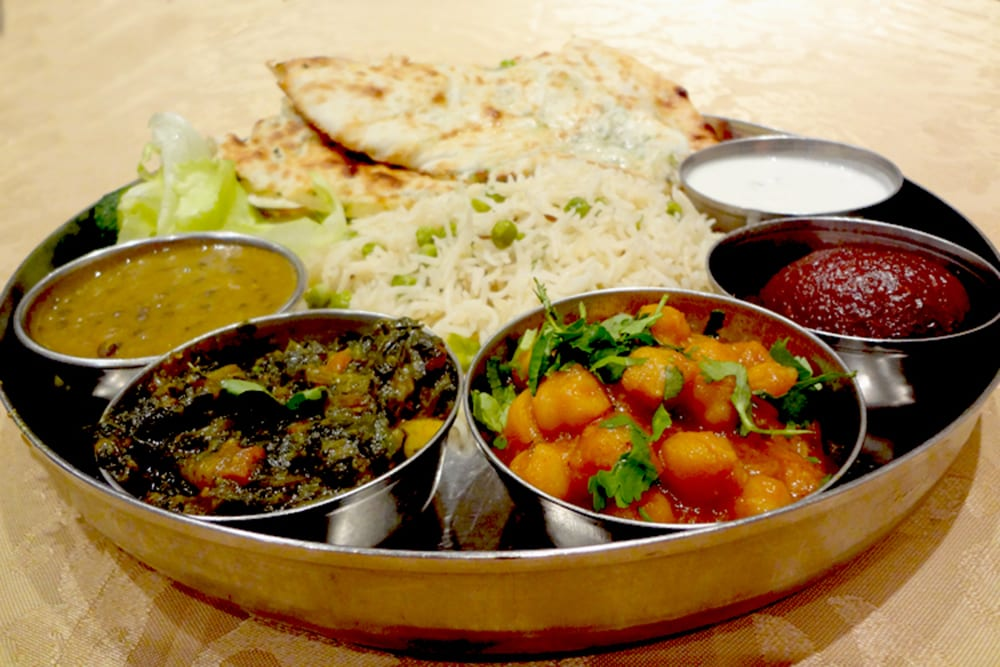 Original Vegetable Thali Meal with Dal, Raita, Rice Pulao, Aloe Parantha, and Gulab Jamun at Original Tandoori Kitchens