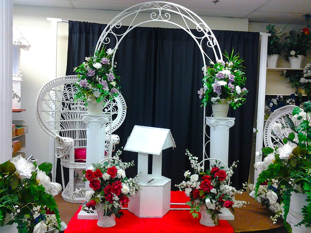 Wedding Arches, garland chairs, and pillars at Surdel Party Rentals