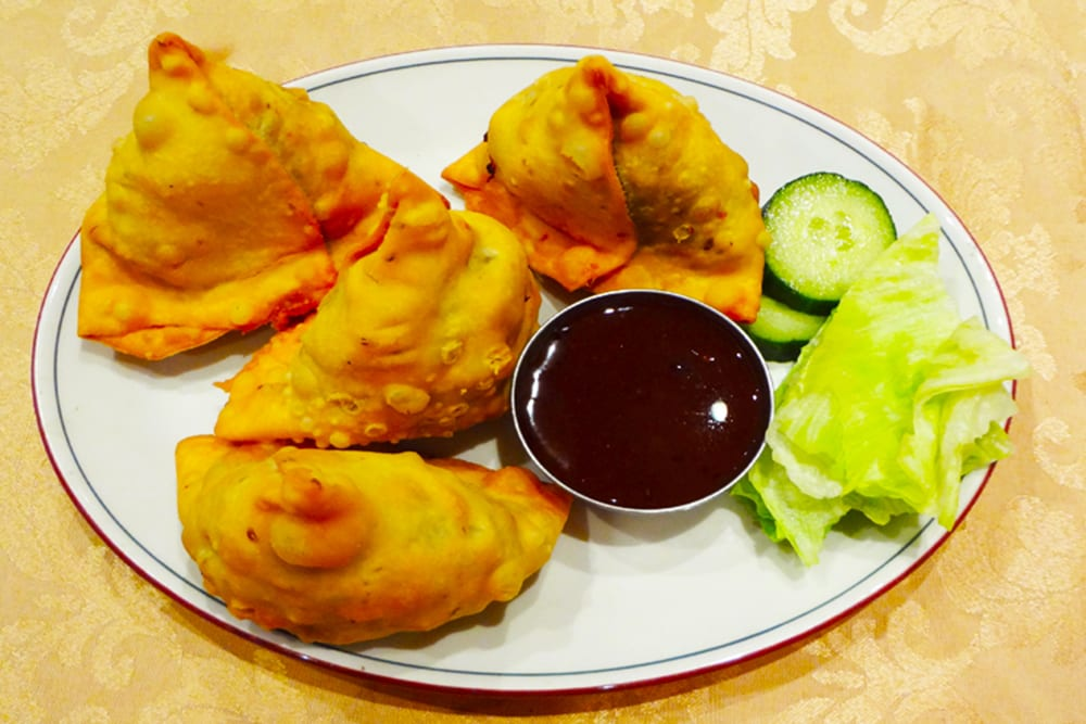 Vegetable Samosa ~ Two crisp patties stuffed with potatoes, peas and spices at Original Tandoori Kitchens